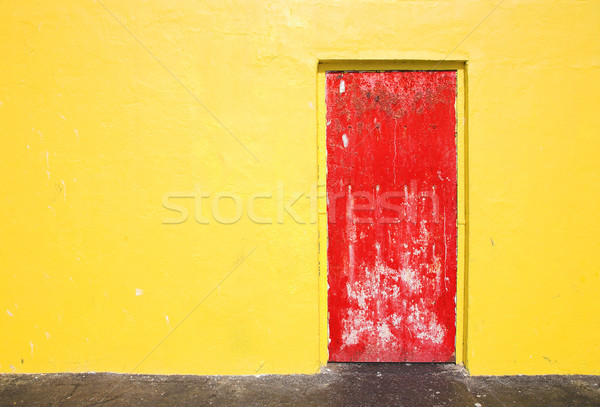 Red door on yellow wall Stock photo © lubavnel