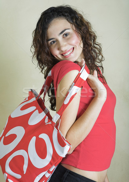 Beautiful young woman with red bag. Stock photo © lubavnel