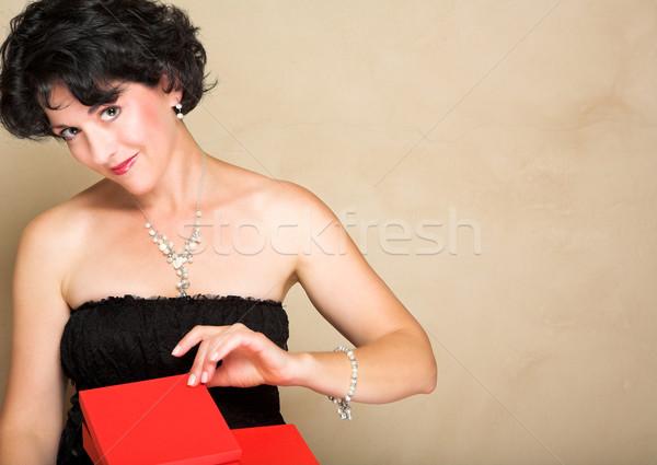 Mujer rojo regalo encaje vestido negro corto Foto stock © lubavnel