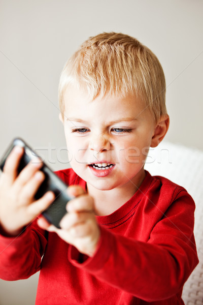 boy with media player Stock photo © lubavnel