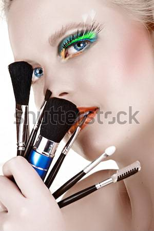 Make-up brushes on blond woman. Stock photo © lubavnel