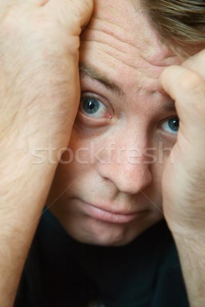 Félénk fiatalember rejtőzködik arc kezek kék Stock fotó © lubavnel