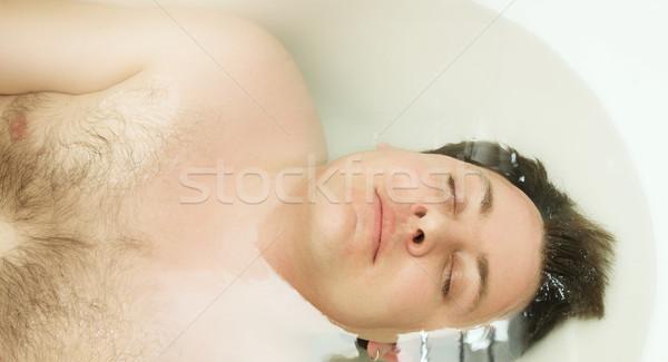 Young man in bath Stock photo © lubavnel