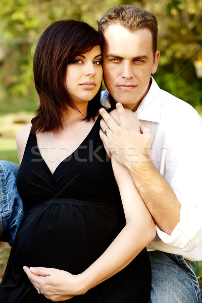 Beautiful happy expecting couple outdoors Stock photo © lubavnel