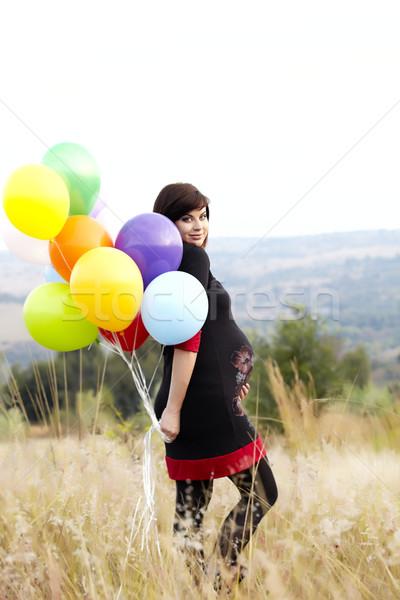 Hamile kadın balonlar çim güzel sekiz ay Stok fotoğraf © lubavnel