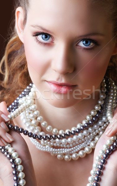 Blond woman in pearls. Stock photo © lubavnel