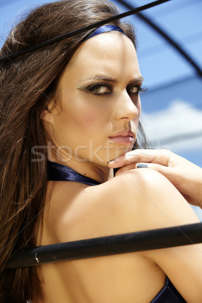 beautiful woman looking over shoulder Stock photo © lubavnel