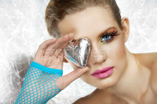 Blond beautiful woman with heart. Stock photo © lubavnel