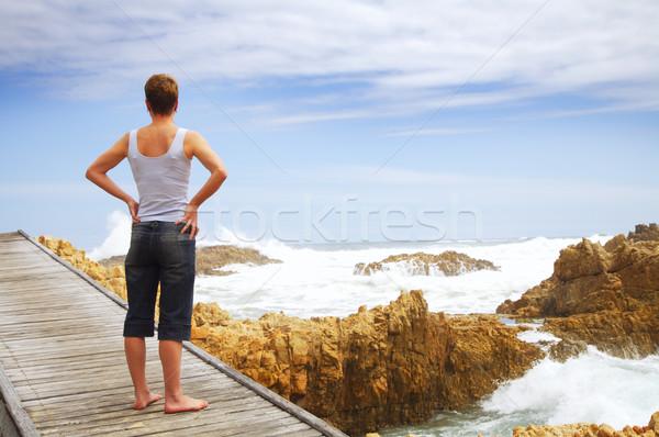 Young woman on bridge over ocean Stock photo © lubavnel