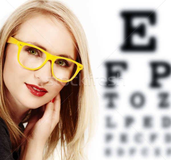woman with yellow glasses. Stock photo © lubavnel