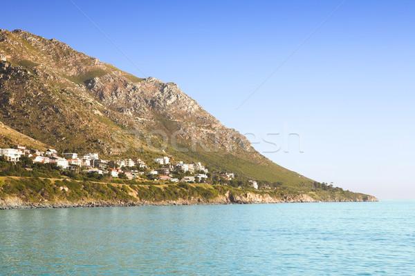 Houses next to ocean Stock photo © lubavnel