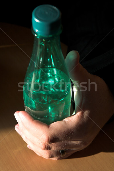 Mineral water bottle in natural light Stock photo © lubavnel