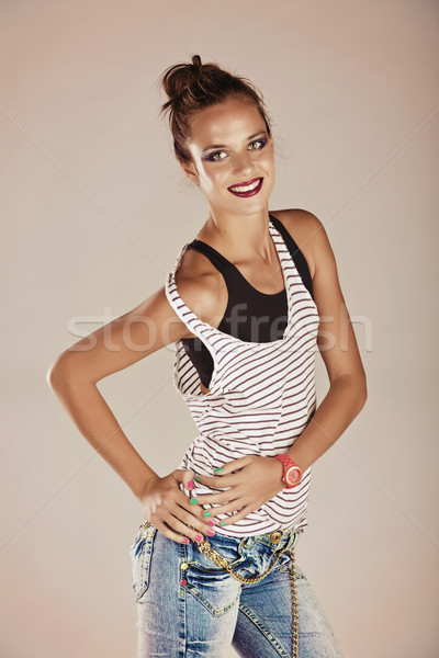 young woman in jeans and striped top Stock photo © lubavnel