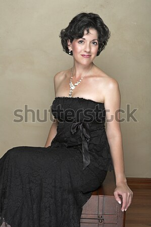 Beautiful happy adult woman with black curly hair . Stock photo © lubavnel