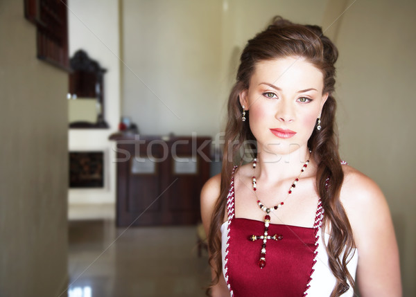 Beautiful bride with long hair in red and white dress Stock photo © lubavnel