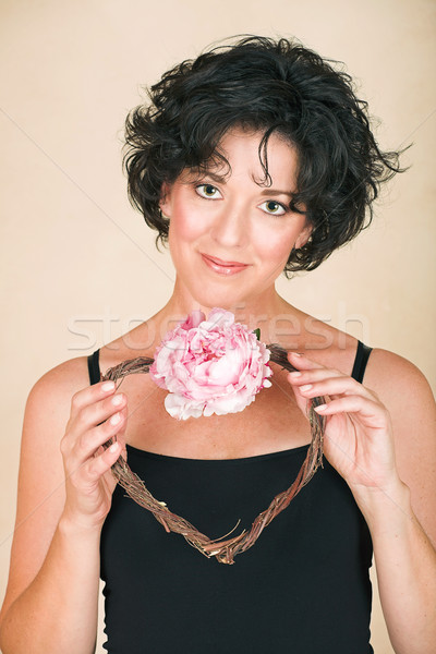 Woman with flower heart Stock photo © lubavnel