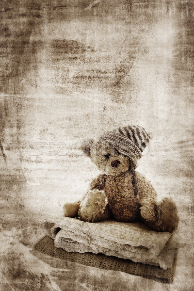 Stock photo: Grunge teddy bear.