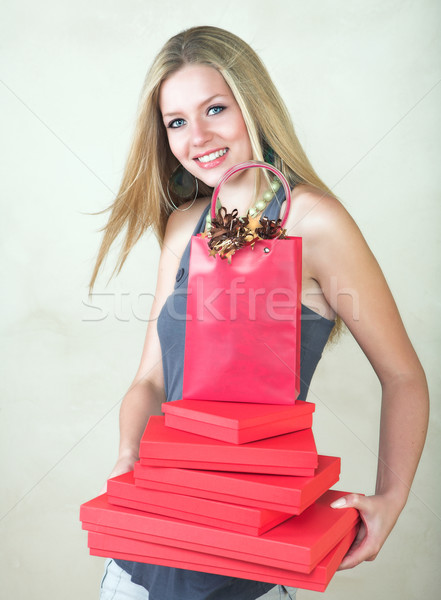 Blond woman with red gift Stock photo © lubavnel