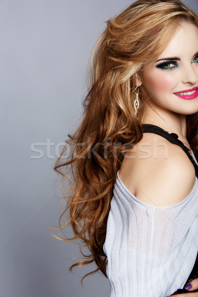 smiling woman with long curly hair and pink lipstick Stock photo © lubavnel