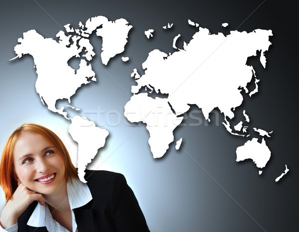 positive businesswoman and map of the world. Stock photo © lubavnel