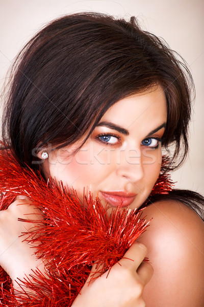 Woman with red tinsel Stock photo © lubavnel