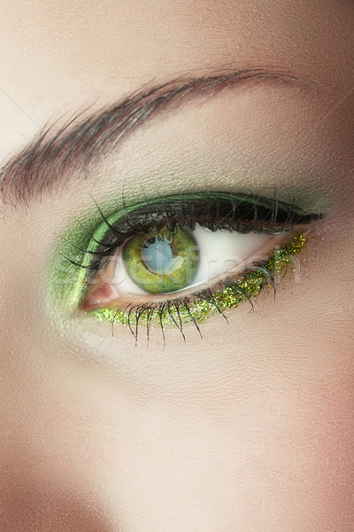 eye of woman with green make-up Stock photo © lubavnel