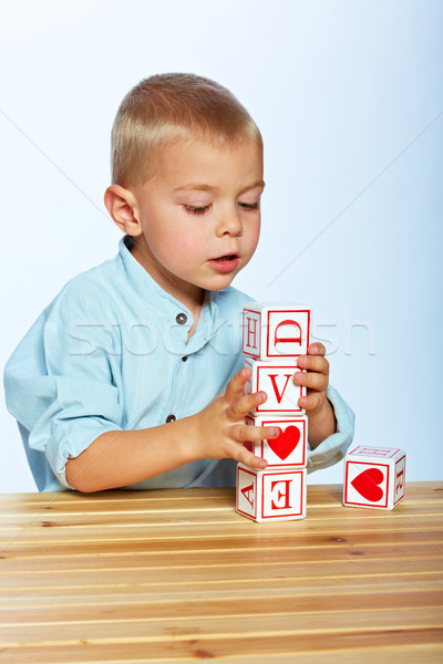 boy playing with alphabet blocks Stock photo © lubavnel