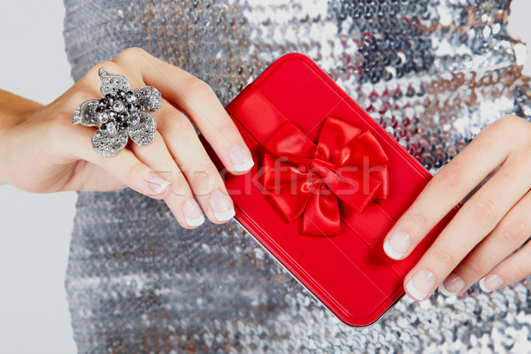 red gift box in woman's hands. Stock photo © lubavnel