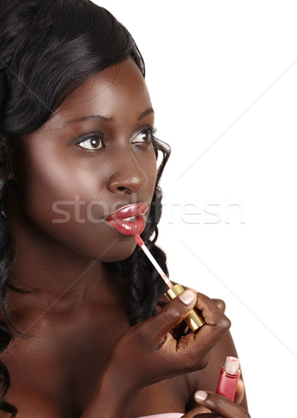 African beautiful woman with lip gloss Stock photo © lubavnel