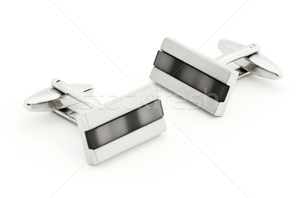 Pair of silver cuff links over white Stock photo © lucielang