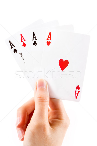 Aces being held over white Stock photo © lucielang