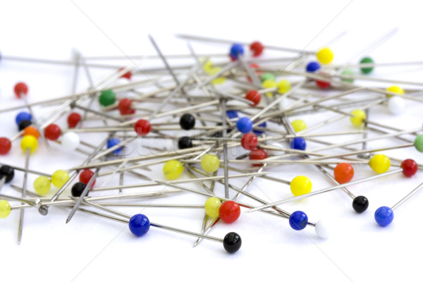 Sewing pins on a white background Stock photo © lucielang