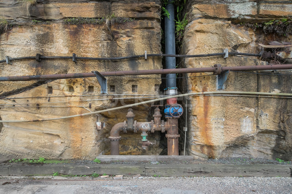 Old rusty industrial pipes in a wall Stock photo © lucielang
