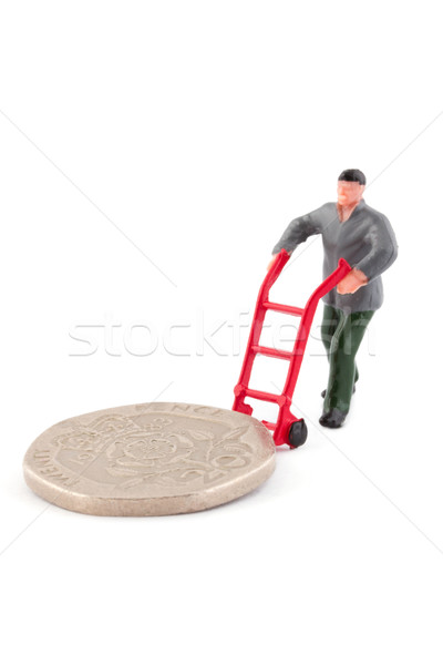Minature figure moving a coin over white Stock photo © lucielang