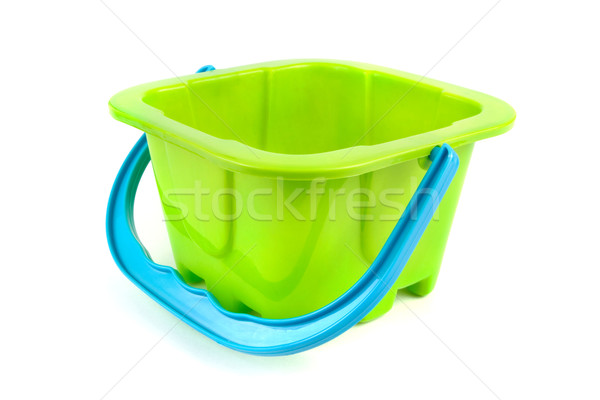 Green plastic kids bucket on white Stock photo © lucielang