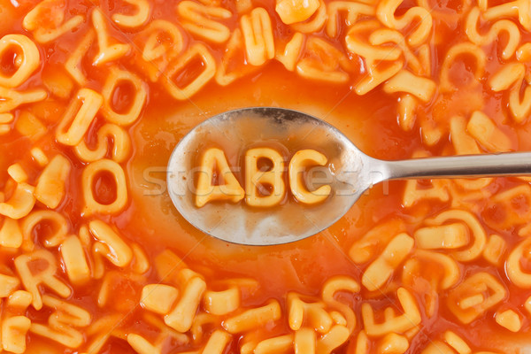 Pasta shaped ABC letters in tomato sauce on a spoon  Stock photo © lucielang