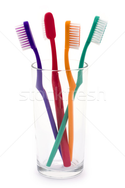 Colourful toothbrushes in a glass Stock photo © lucielang