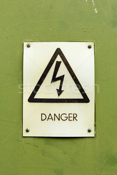 Danger electricity sign on a green background Stock photo © lucielang