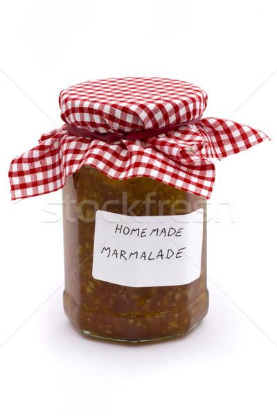 Jar of homemade marmalade over white Stock photo © lucielang