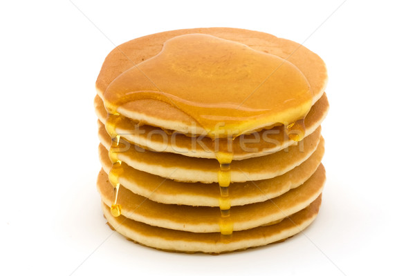 Stack of fluffy pancakes with drizzled syrup  over white Stock photo © lucielang