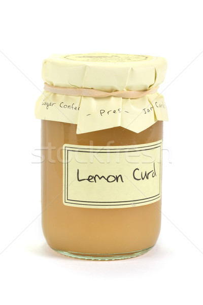 Jar of home made lemon curd on white Stock photo © lucielang