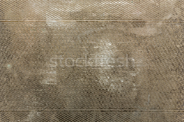 Tarnished grungy patterned metal background Stock photo © lucielang