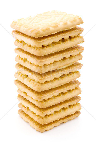 Tower of cream filled biscuits over white Stock photo © lucielang