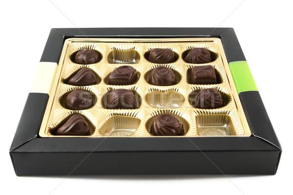 Half eaten box of chocolates over white Stock photo © lucielang