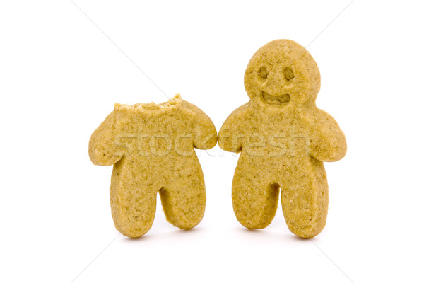 Two gingerbread men one with head bitten off Stock photo © lucielang