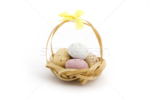 Basket of candy coated chocolate easter eggs Stock photo © lucielang