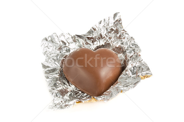 Heart shaped chocolate in a foil wrapper Stock photo © lucielang