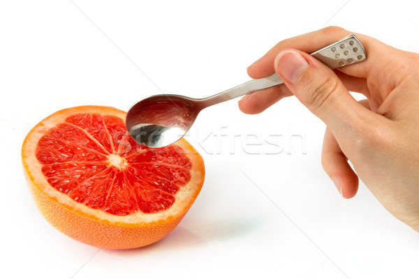 Pink grapefruit with hand holding a spoon Stock photo © lucielang