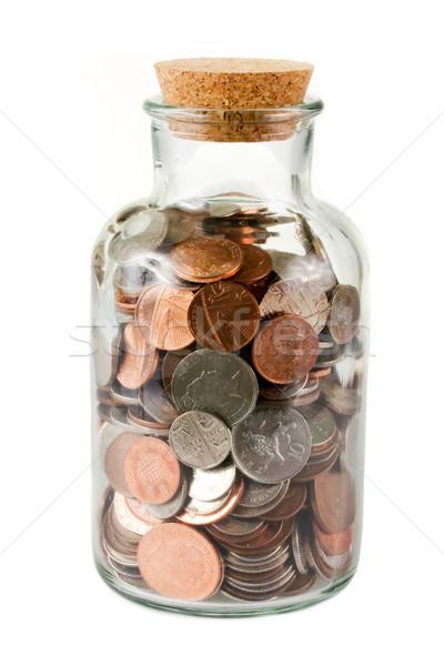 Glass bottle full of coins Stock photo © lucielang