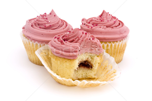 Three pink cupcakes over white. Stock photo © lucielang